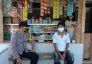 Bhabinkamtibmas melaksanakan kunjungan dan himbauan prokes di wilayah binaan